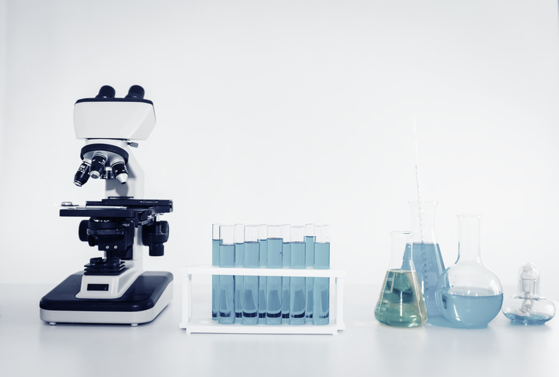 Laboratory microscope of healthcare and medicine researcher scientist with lab equipment tools on the table.